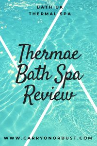blue water image text says thermae bath spa review carry on or bust